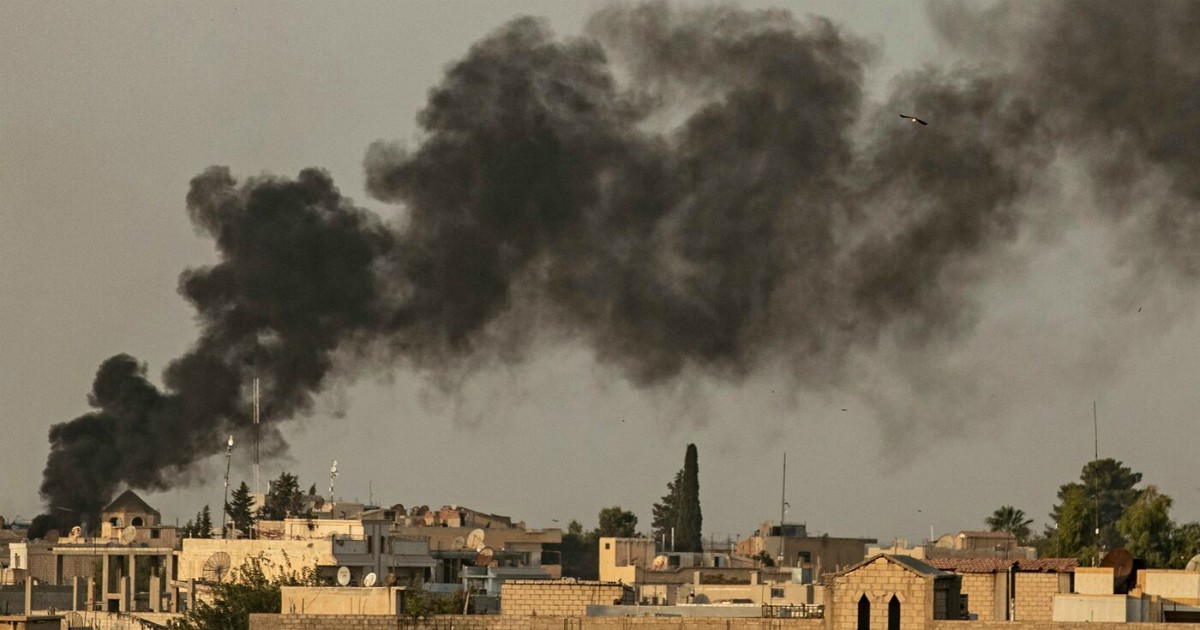 """Smoke billows following Turkish bombardment on Syria's northeastern town of Ras al-Ain in the Hasakeh province along the Turkish border on October 9, 2019. - Turkey launched an assault on Kurdish forces in northern Syria with air strikes and explosions reported along the border. President Recep Tayyip Erdogan announced the start of the attack on Twitter, labelling it """"Operation Peace Spring"""". (Photo by Delil SOULEIMAN / AFP)"""